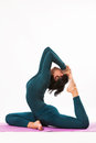 Balance woman in king pigeon position yoga eka pada rajakapotasana studio shot Stock Images