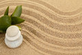 Balance zen stones in sand and green leaves Royalty Free Stock Image
