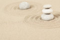 Balance zen stones in sand of three Stock Photo
