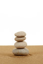 Balance zen stones in sand on white Royalty Free Stock Photo