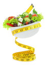 Balanced diet with salad measuring tape bowl Royalty Free Stock Photo