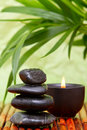 Balanced pebbles and aromatherapy candle Royalty Free Stock Photo