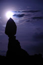 Balanced rock and moon in arches national park night with full Stock Image