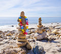 Balanced rocks stack of sea with decoration balancing by pacific ocean Stock Photo