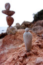 Balanced Rocks with Stone Figure Royalty Free Stock Photo