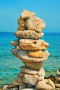 Balanced stones on the beach in the summer a stack of Royalty Free Stock Photography