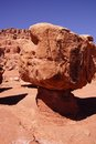 Balancing rock on tiny pedestal Royalty Free Stock Photo