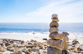 Balancing rocks stack of sea with sign dream on the top by pacific ocean Stock Images