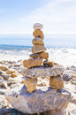 Balancing rocks stack of sea with sign dream on the top by pacific ocean Stock Photography