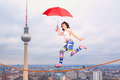 Balancing on a rope woman in unrealistic cartoon style Stock Images