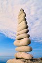 Balancing of stones white pebbles each other on the seacoast Stock Photo