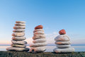 Balancing three piles pebbles near sea Royalty Free Stock Image