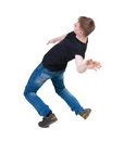 Balancing young man or dodge falling man the in black t shirt and jeans falls rear view people collection backside view of Stock Images