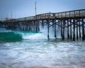 Balboa pier waves crashing beneath at newport beach california Stock Image