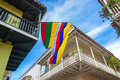 Balconies and flags colonial with a colombian flag in the historic center of cartagena colombia Royalty Free Stock Photos