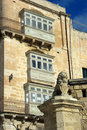 Balconies And Lion Symbol Of Valletta, Malta Royalty Free Stock Images
