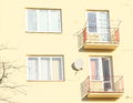 Balconies with satelite antenna of yellow building Stock Photos