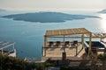 Balcony at Caldera with a view at blue sea and volcano, Fira, Santorini island Royalty Free Stock Photo