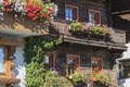 Balcony with flower boxes alp house Royalty Free Stock Photos