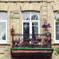Balcony with flowers at summertime Royalty Free Stock Photo