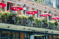 Balcony of le Procope, old restaurant in Paris, with red cafe umbrellas Royalty Free Stock Photo