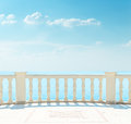 Balcony near sea under cloudy sky Royalty Free Stock Photo