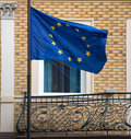 Balcony of the old building with the flag the european union Royalty Free Stock Photos