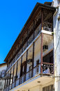 Balcony of an old colonial building in a street in an african ci Royalty Free Stock Photo