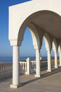 Balcony over aegean sea view the from the porch with arches and columns of orthodox church profitis ilias in keratea near lavrio Stock Photos