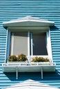 Balcony of villa with blue wooden wall Stock Photo
