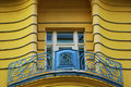 Balcony wih hand crafted fence and a window downtown zagreb building croatia blue sky background roof top of an old in Stock Images