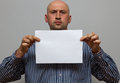 Bald business man is posing with blank copy space Royalty Free Stock Photo