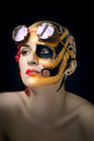 Bald girl with a art make up and steampunk glasses on the one hand mechanical robot on the other blooming desert Stock Image