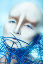 Bald girl with body art on blue background Stock Photography