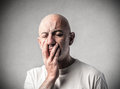 Bald man closing his eyes desperate Royalty Free Stock Photo