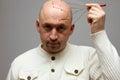 Bald man head massage Royalty Free Stock Photo