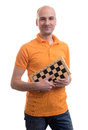 Bald man holding a chessboard isolated on white background Stock Photo