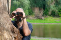 Bald man watching the nature through binoculars Stock Photography