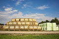 Bale of straw infold in plastic film (foil) to keep dry in autom Royalty Free Stock Photo