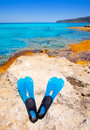Balearic Formentera island with scuba diving fins Royalty Free Stock Photo