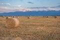 Baled Hay Rolls at Sunset Royalty Free Stock Photo