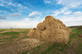 Bales of hay on the farm field evening rural landscape Royalty Free Stock Image