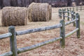 Bales of hay surrounded by a wooden fence Stock Photos