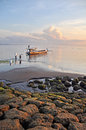 Bali fishermen preparing their boat at dawn at sanur beach indonesia february balinese Stock Photo