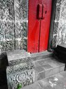 Bali house with red door stone carved walls a photograph showing the beautiful exterior of an old balinese a bright wooden and Royalty Free Stock Images
