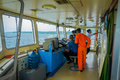 BALI, INDONESIA - APRIL 05, 2017: Ferry boat pilot command cabin with the captain operating the machines with a many