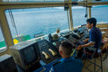 BALI, INDONESIA - APRIL 05, 2017: Ferry boat pilot command cabin with view on the sea with many assistants there in Ubud