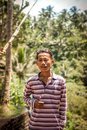 BALI, INDONESIA - DECEMBER 5, 2017: Closeup portrait of asian balinese indonesian man in the jungle of Bali island. Royalty Free Stock Photo