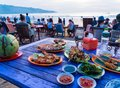 Sea food restaurants on Jimbaran beach in Bali, Indonesia Royalty Free Stock Photo