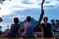 BALI, INDONESIA - MAY 4, 2017: Three women on a background of Pura Tanah lot temple, Bali island, Indonesia. Sunset time Royalty Free Stock Photo